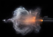 Bullet Photography...PIC BY HERRA KUULAPAA / CATERS NEWS - (PICTURED: A bullet being fired from a gun) - These incredible photos capture the awe-inspiring, split-second moment a bullet leaves the barrel of a gun. The shots capture a wide range of firearms, focusing on the moment of action when the bullet begins spinning through the air. High speed ballistics photographer, Herra Kuulapaa has created a series of incredible photos of guns firing bullets in amazing pin sharp pictures.s.